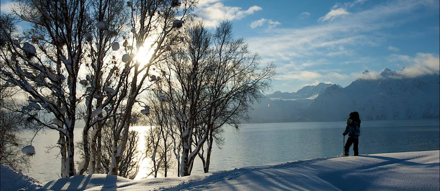 View across the lake in winter at Lyngen Lodge in Norway
