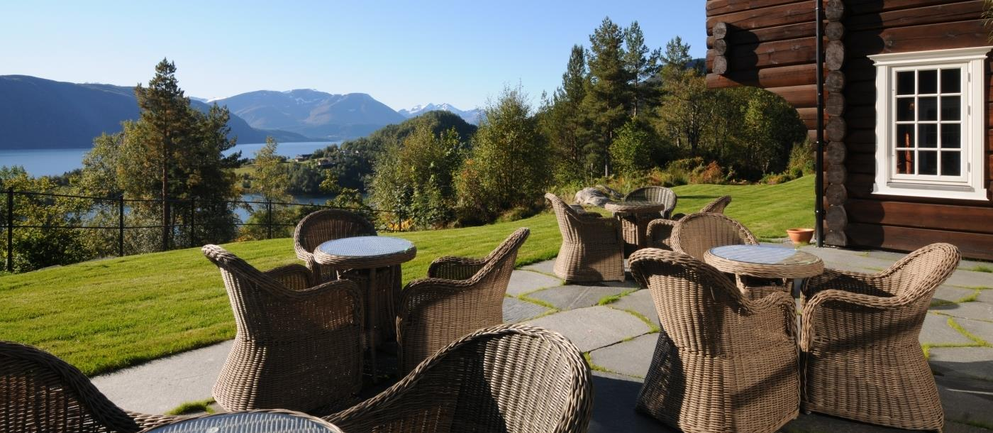 Open outdoor terrace with view of fjord at Storfjord Hotel in Norway