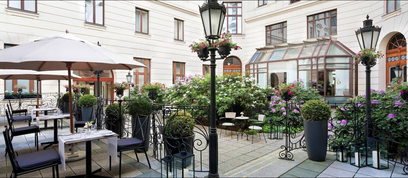 Courtyard with dining at Hotel Bristol in Warsaw Poland