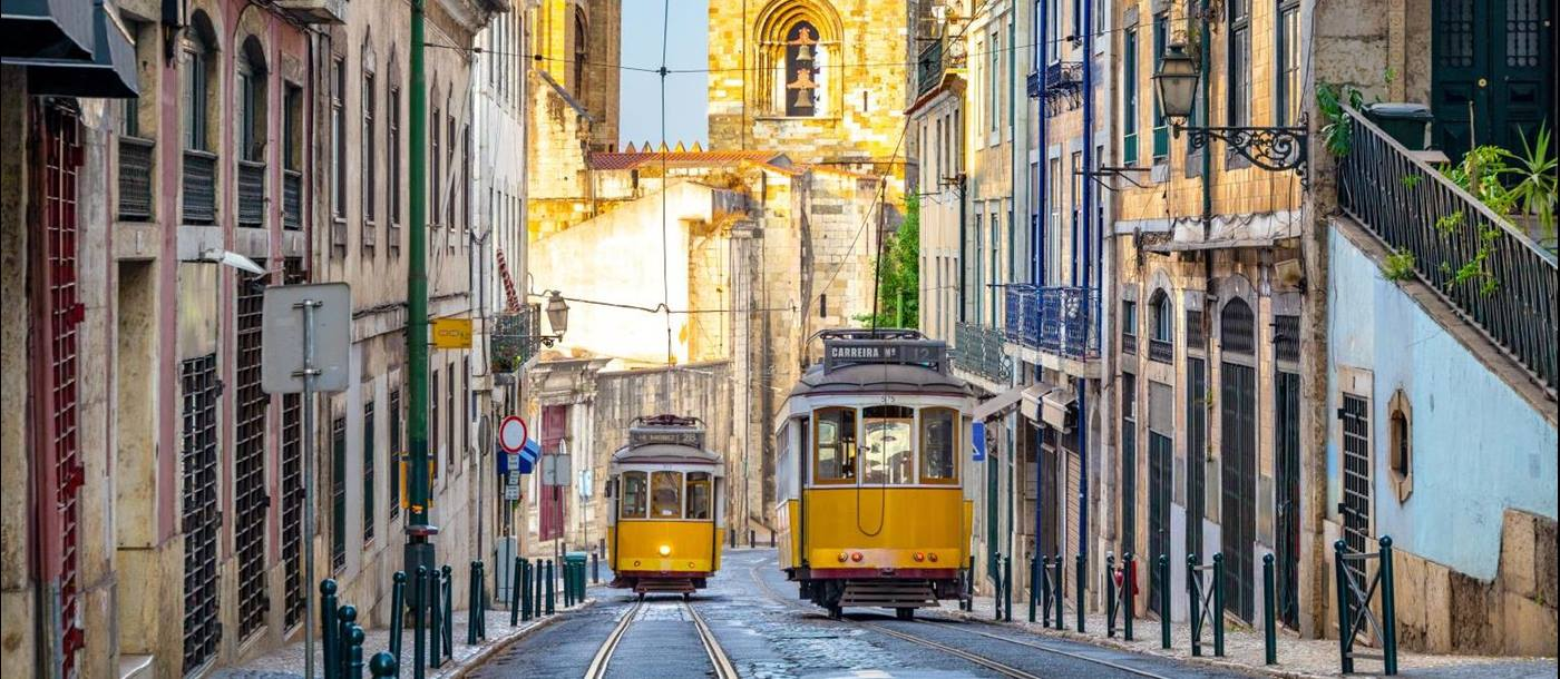 Yellow trams on the streets of Lisbon's historic nieghbourhoods