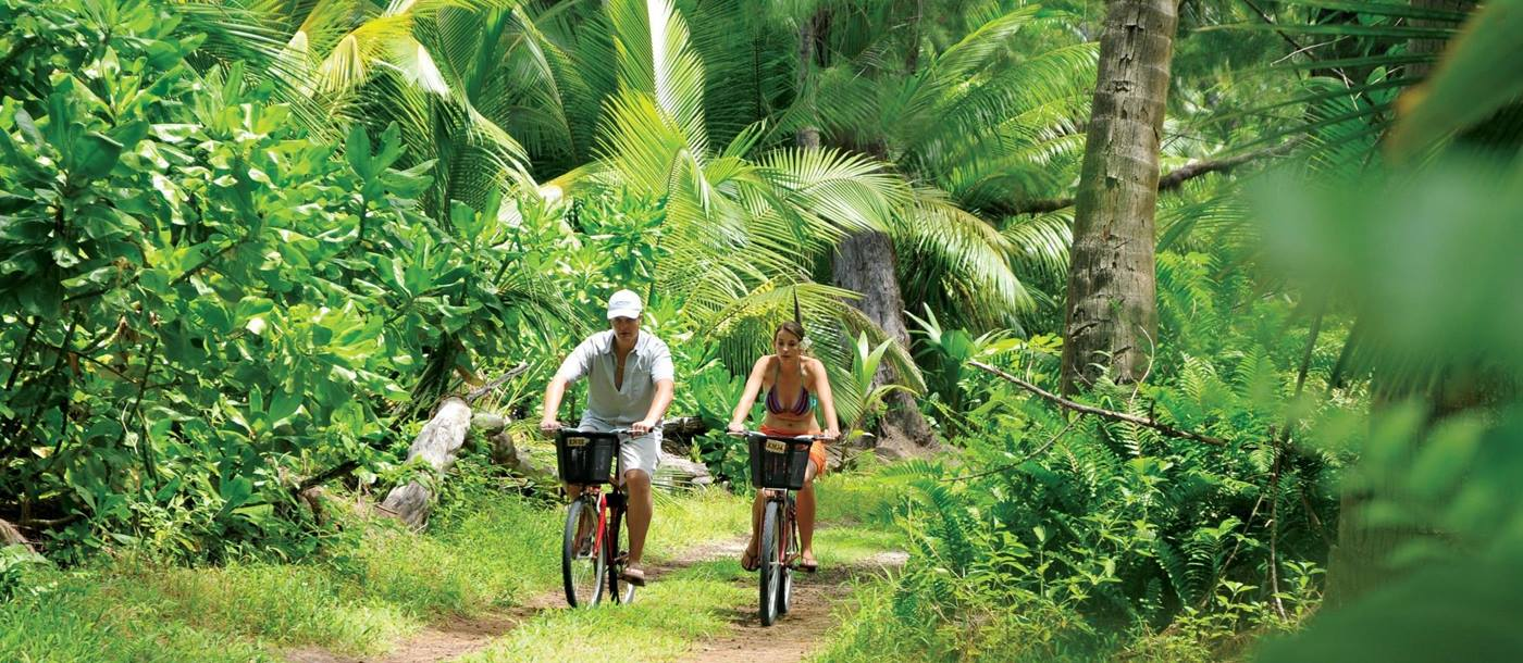 Two bikers in the jungle at Desroches, Seychelles