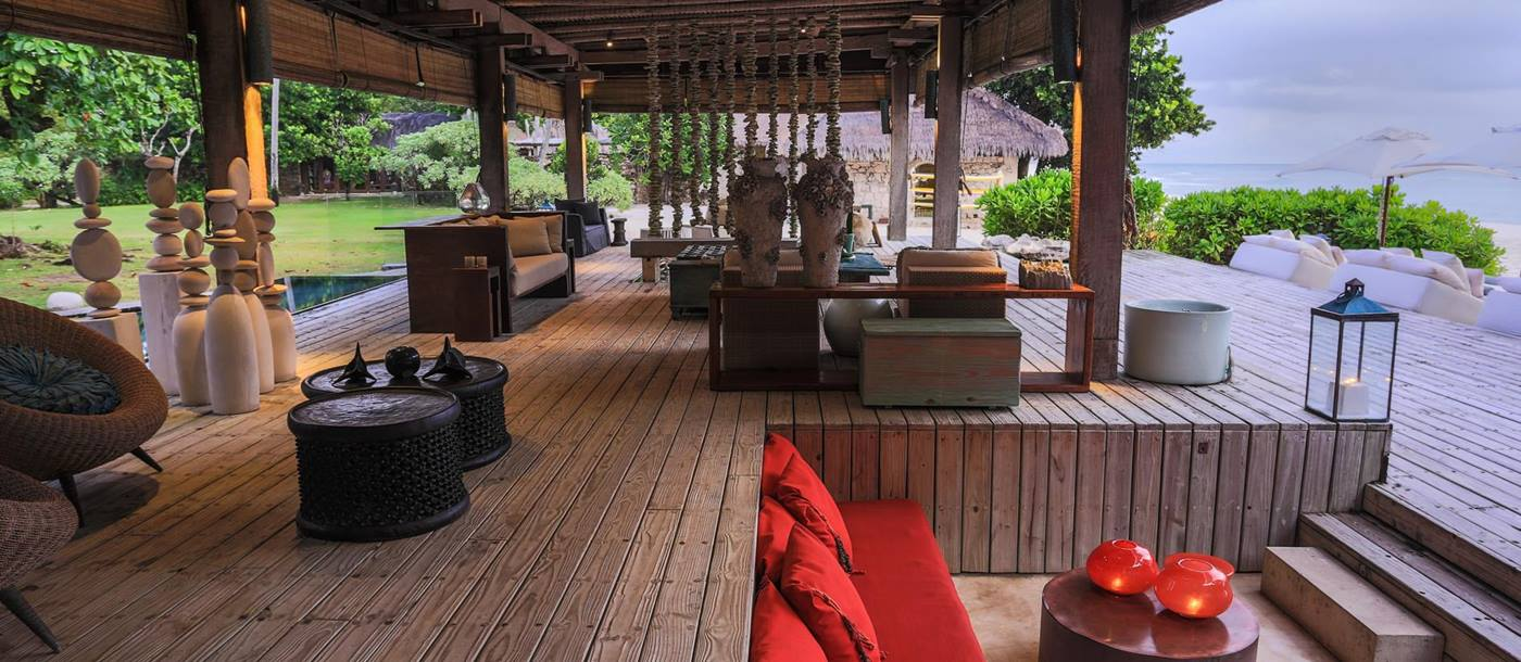 Relaxation area of The deck of a villa at North Island, Seychelles