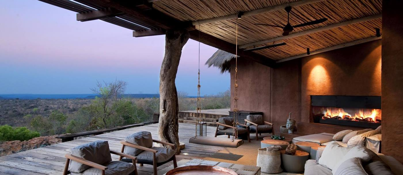 Outdoor covered terrace with fireplace at Leobo the Observatory, South Africa