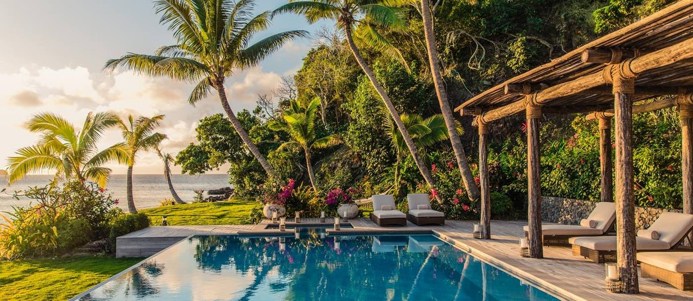 Swimming pool of a beachfront residence on Kokomo Island, Fiji