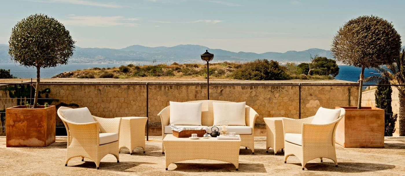 Terrace seating with views across the bay at luxury resort Cap Rocat on Mallorca, Spain
