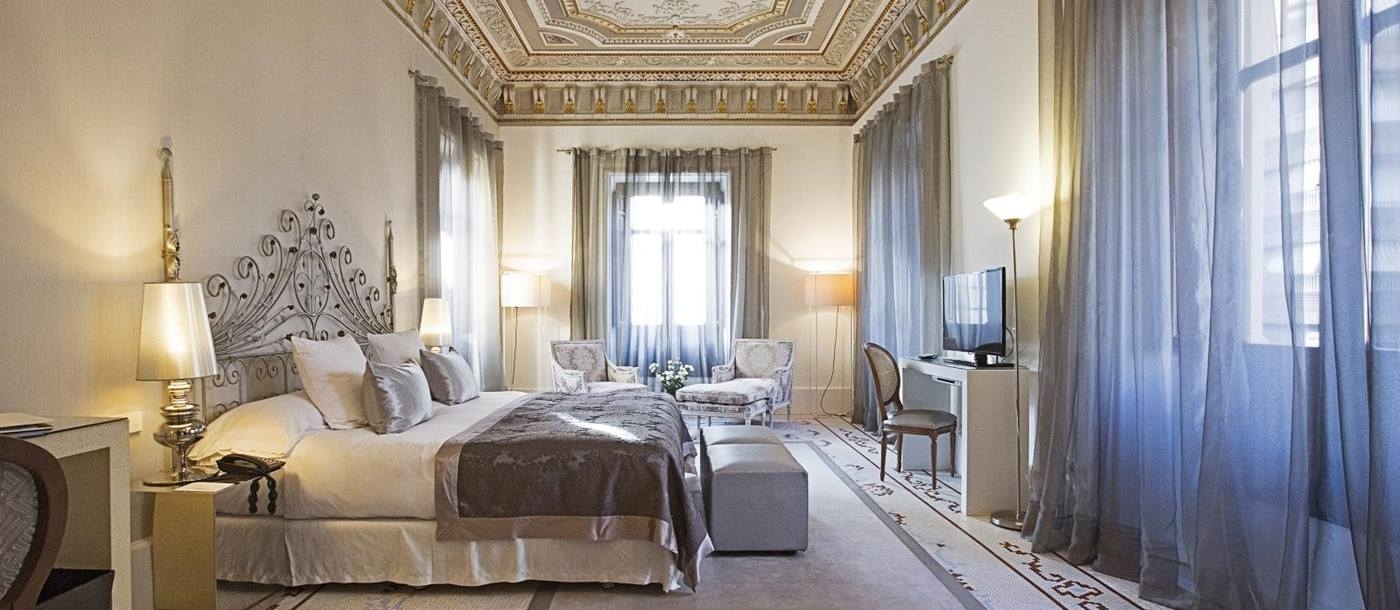 Large presidential suite with ornate ceilings at Hospes Palacio de Los Patos in Spain