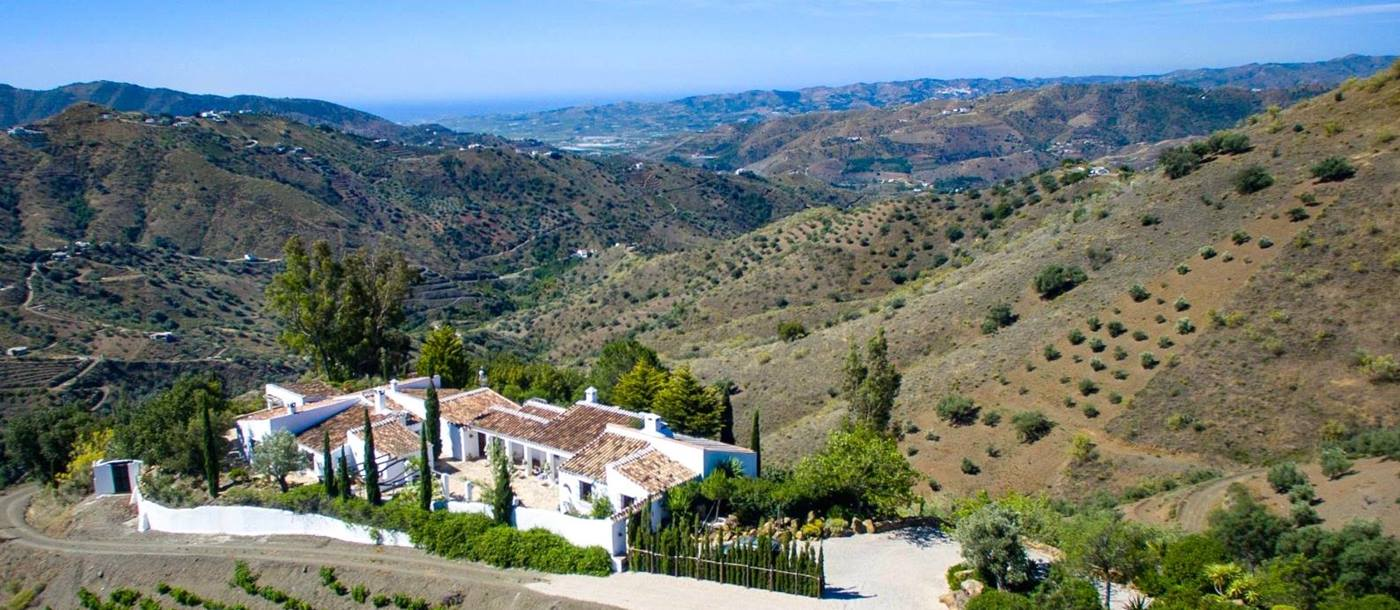 Aerial shot of El Cortijo and its magnificent views over the Andalucian hills