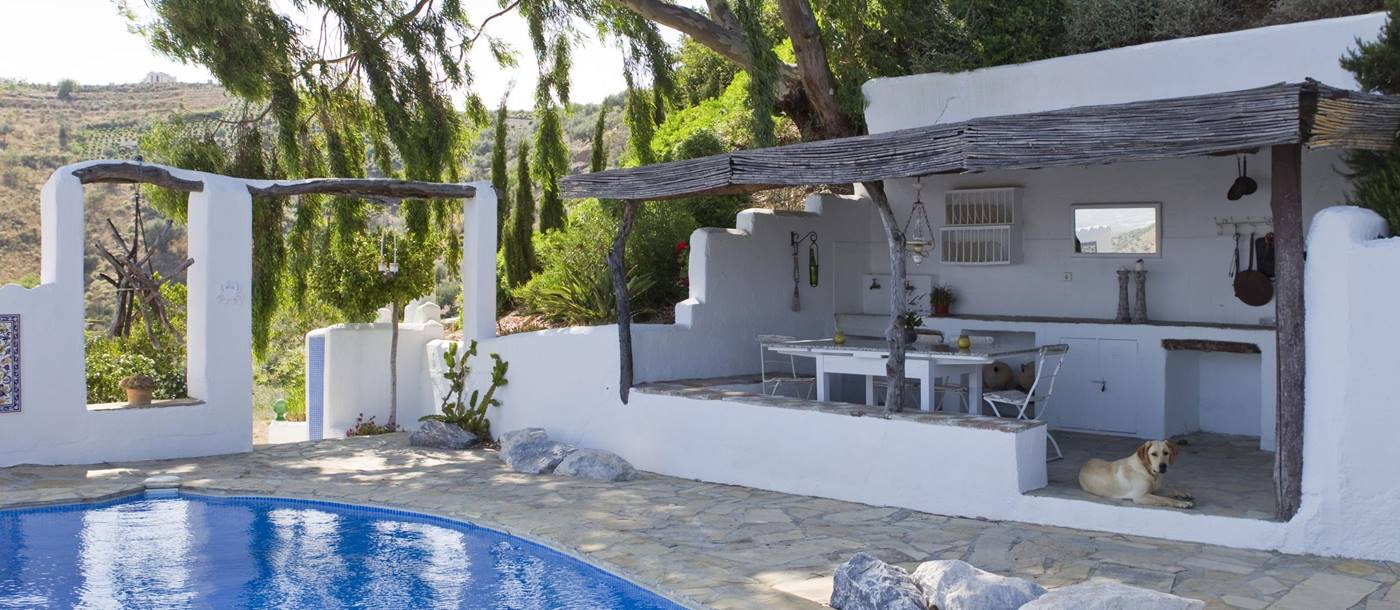 The swimming pool and the summer house of El Cortijo, Andalucia