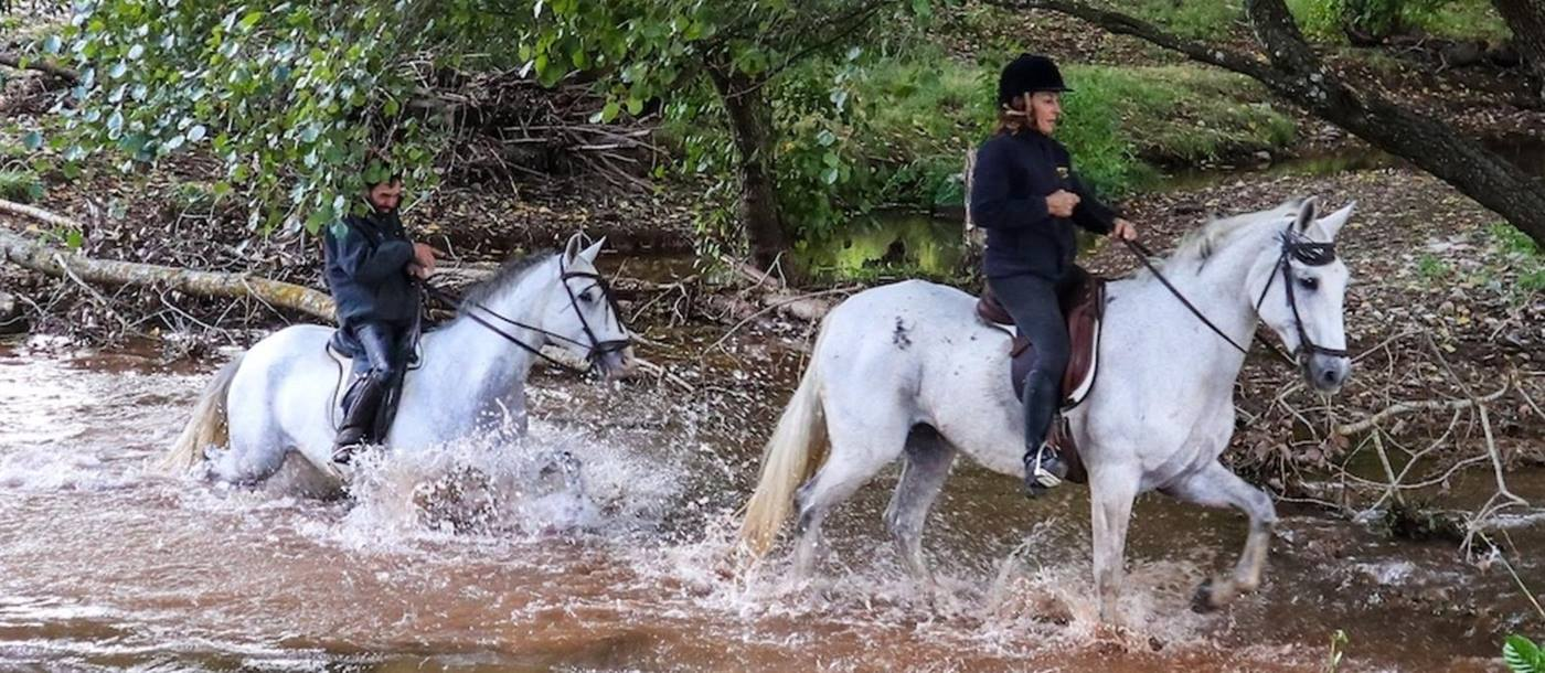 Riding through water in Andalucia in Spain