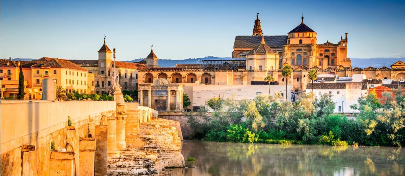 Roman bridge and great Mosque over water in Cordoba Spain