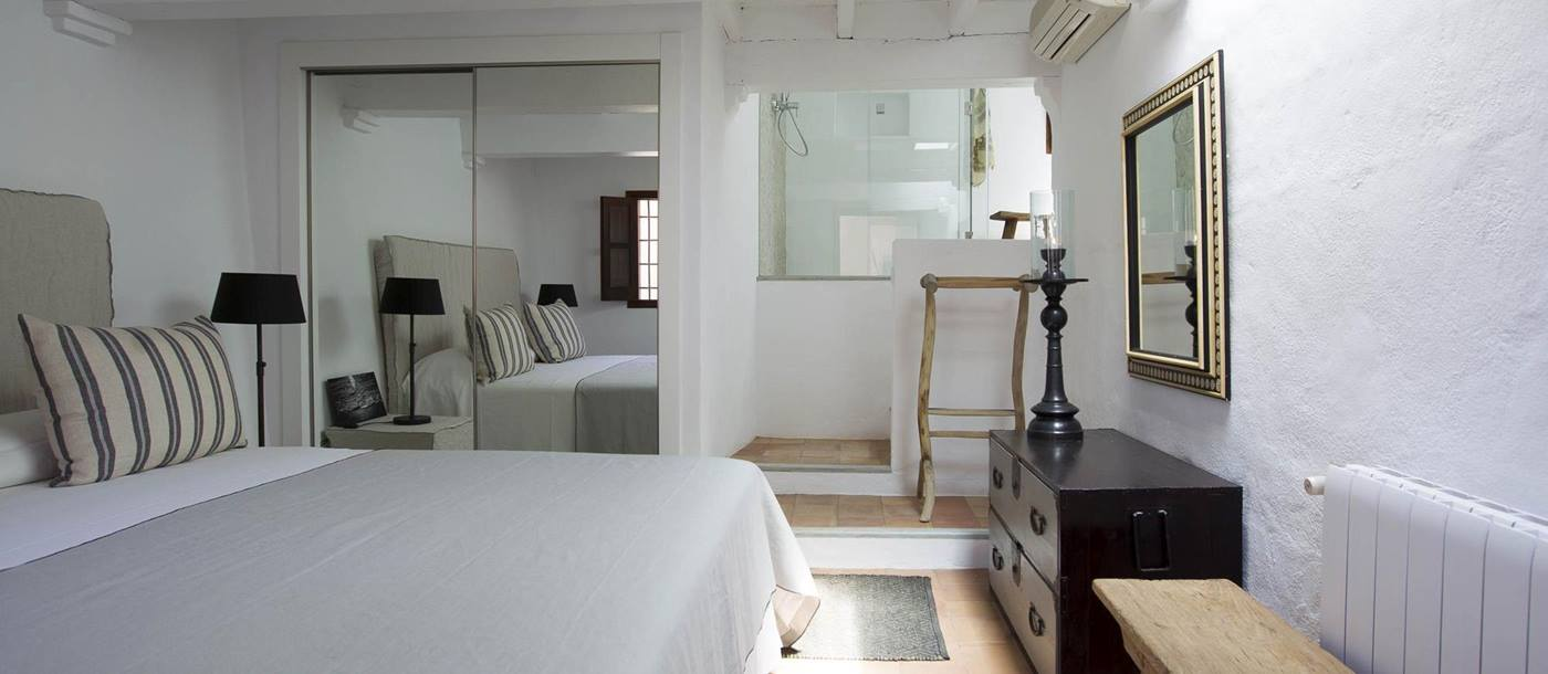Bedroom with large double bed at Villa Palio in Ibiza