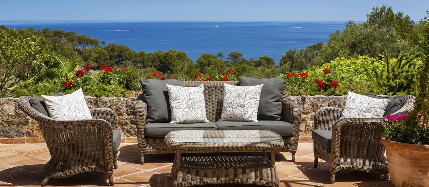Terrace seating area with views over the surrounding area and the Mediterranean Sea