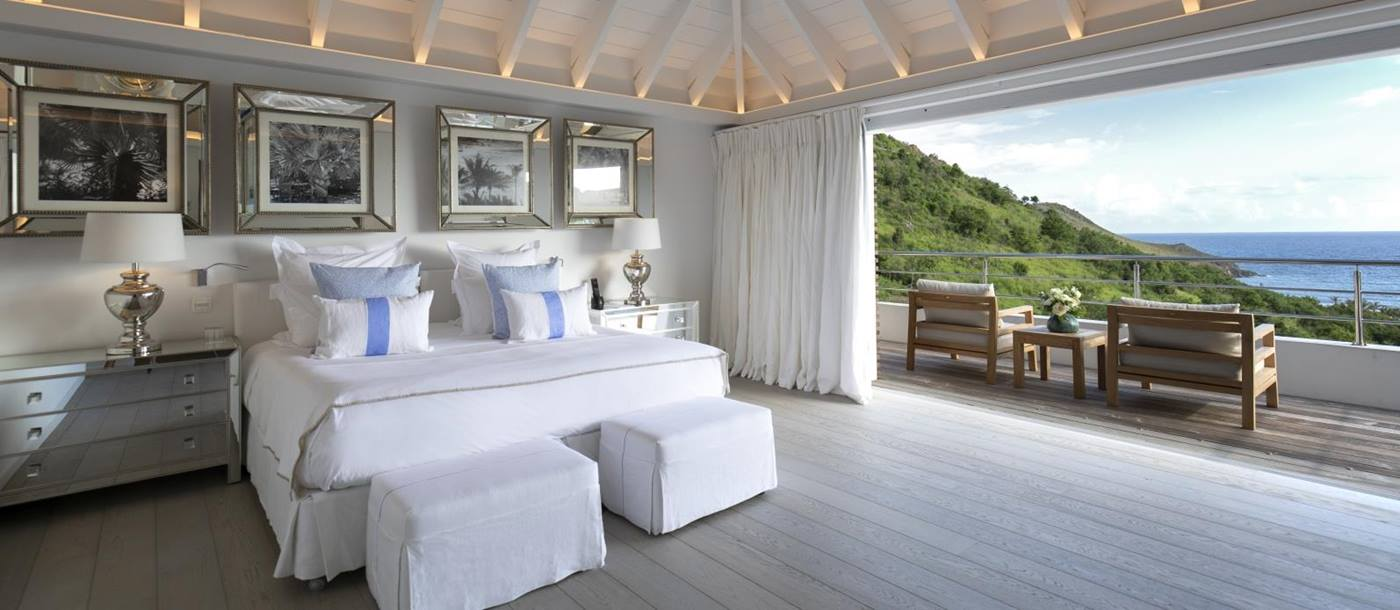 Bedroom with open balcony views over the sea