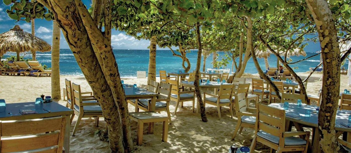 Dining under the trees at Hotel Le Toiny