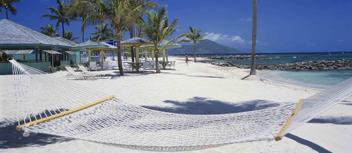 A hammock above the white beach of Nisbet Plantation, Nevis