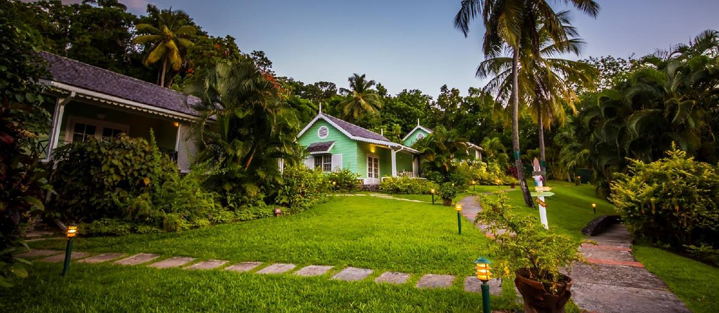 The garden setting of deluxe cottages in East Winds, St Lucia