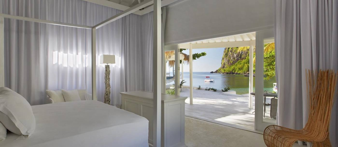 Double bedroom of a Luxury Beachfront Bungalow at Private beach dining at Sugar Beach, St Lucia