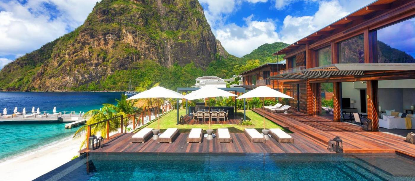 Swimming pool at Sugar Beach St Lucia with backdrop of the Pitons