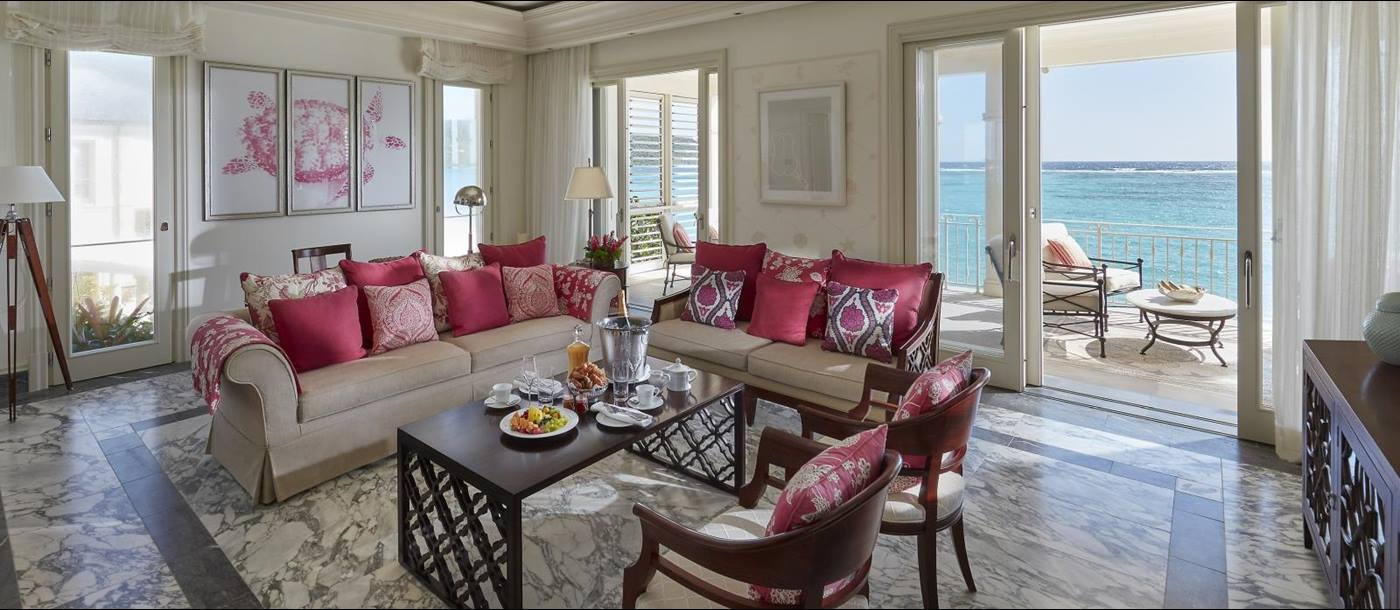 The living room of the Penthouse Suite with a terrace overlooking the ocean