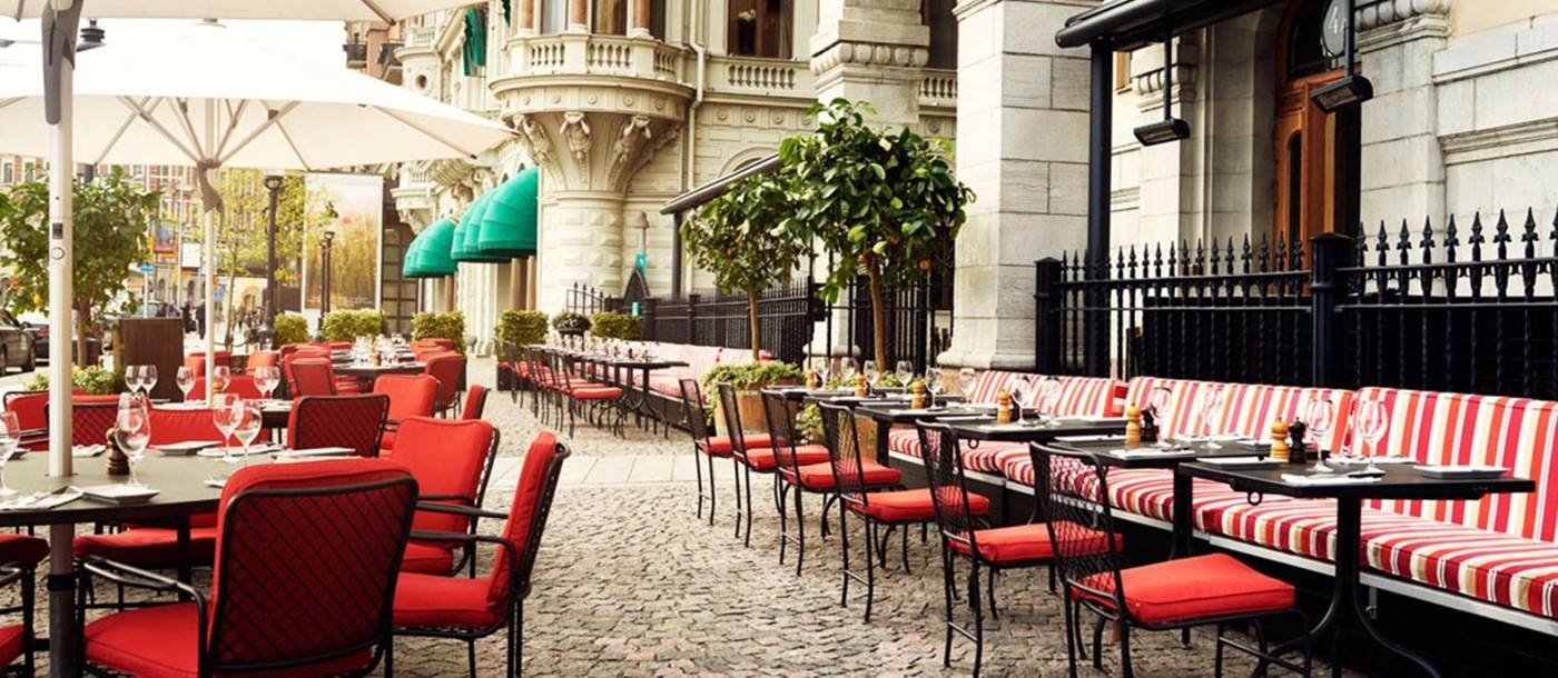 Outdoor seating on a cobbled square with parasols