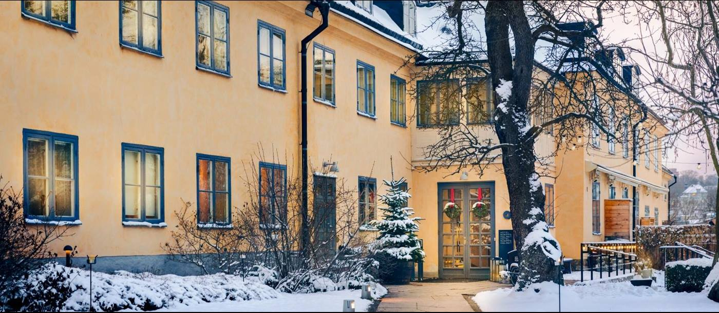 Path to the entrance of Hotel Skeppsholmen in the snow