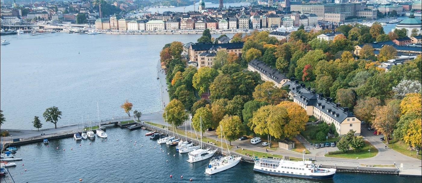 Aerial view of Hotel Skeppsholmen with the sea and city in the background