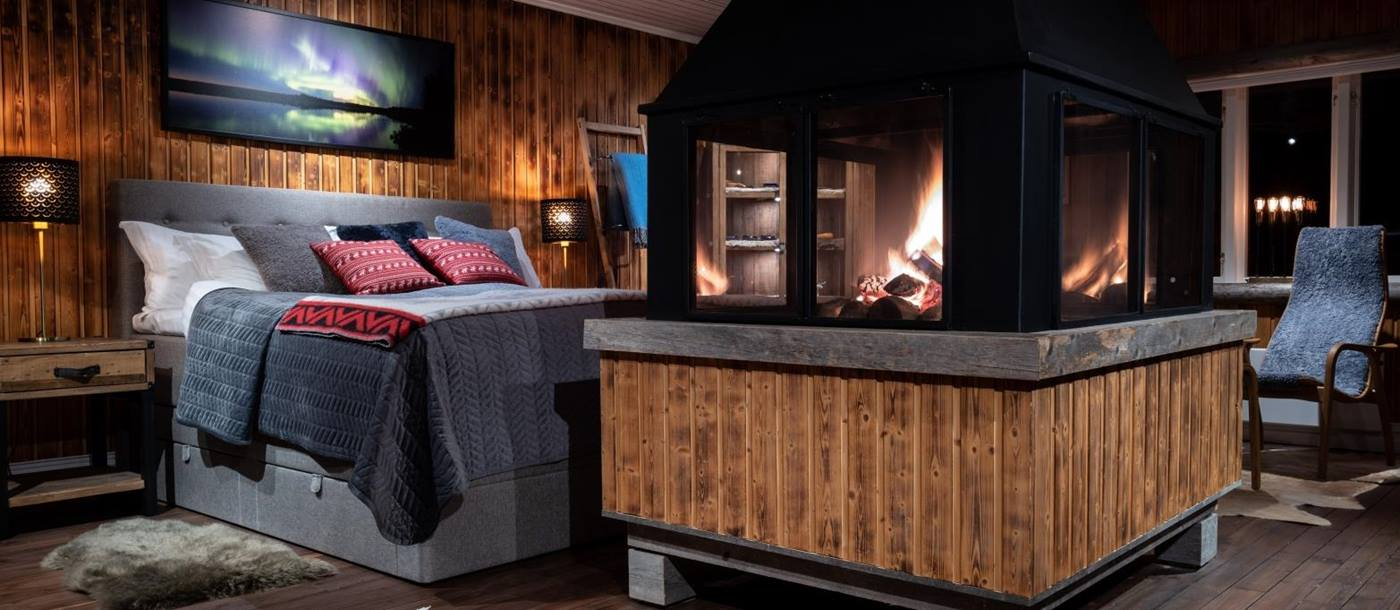 Bedroom and fire place view at Loggers Lodge