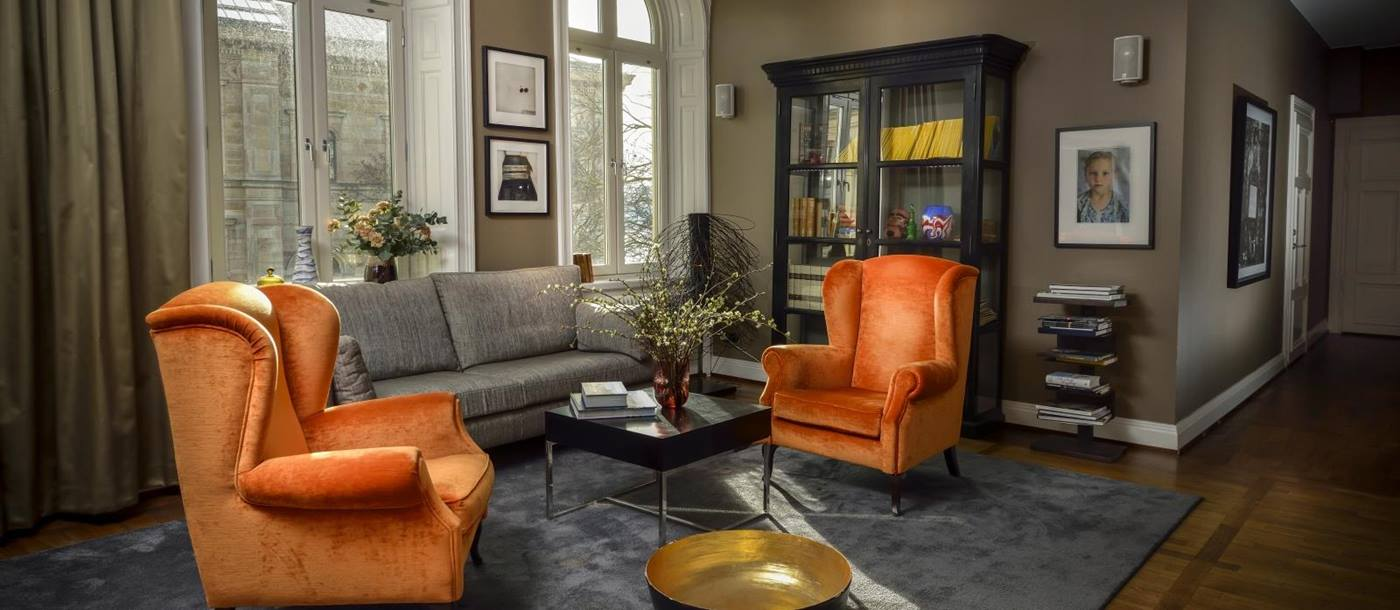 Two orange armchairs at Lydmar Hotel