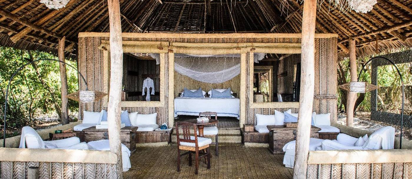 A double bedroom of andBeyond Mnemba Island Lodge, Zanzibar
