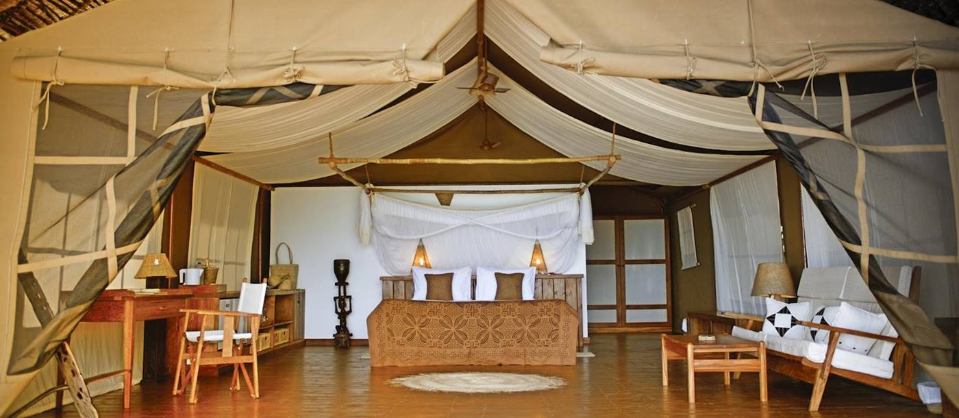 A superior suite bedroom at Fundu Lagoon