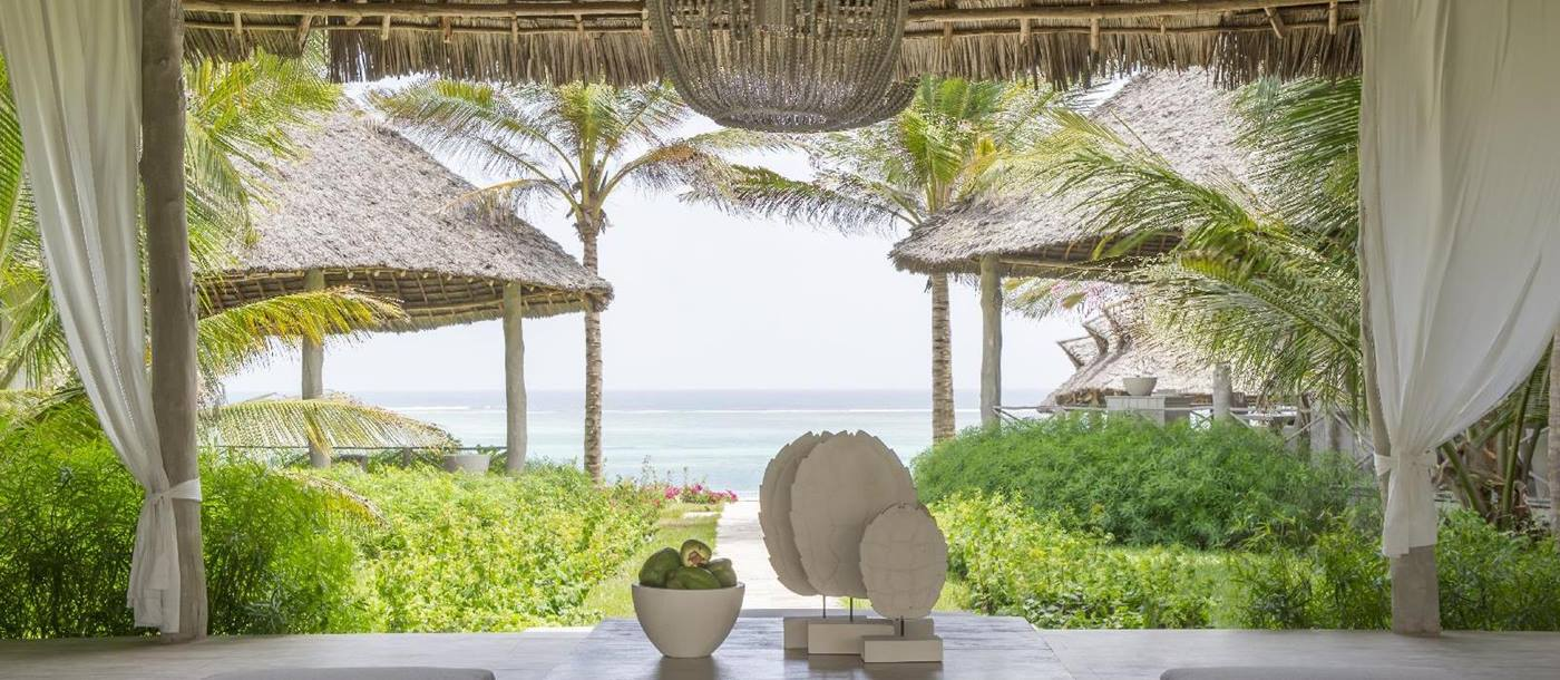 the reception with view over the ocean of the sun deck with a view over the beach at Zawadi, Tanzania