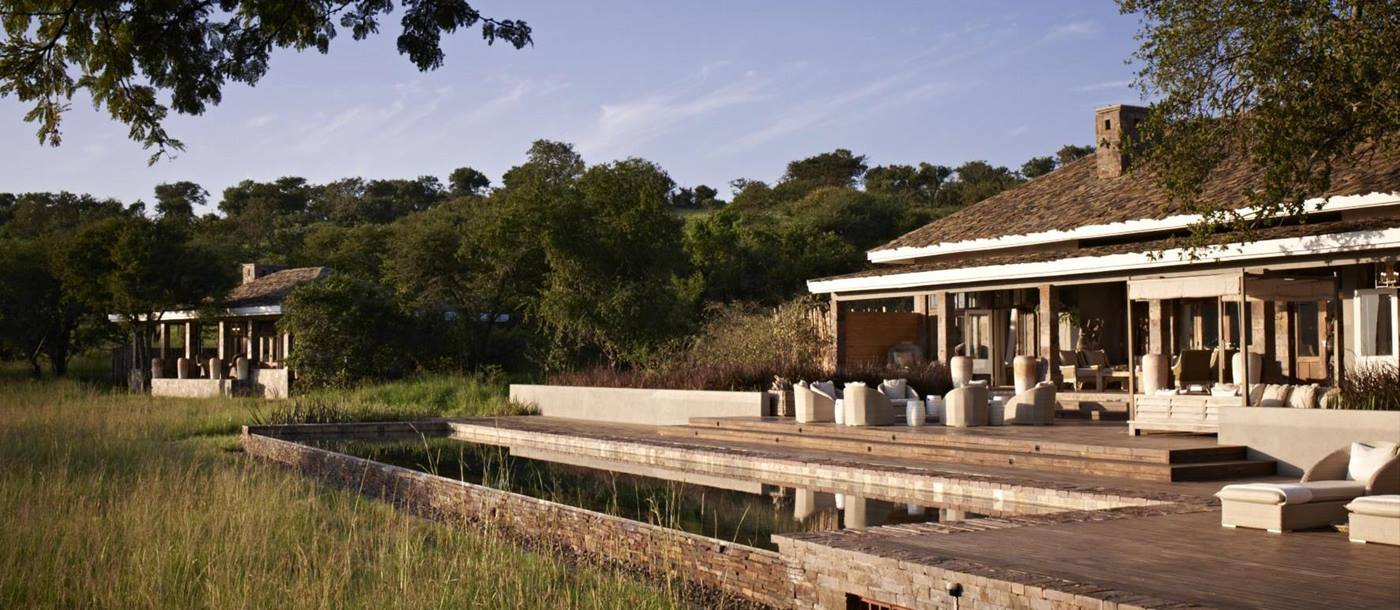 The pool and grounds at Singita Seregeti House