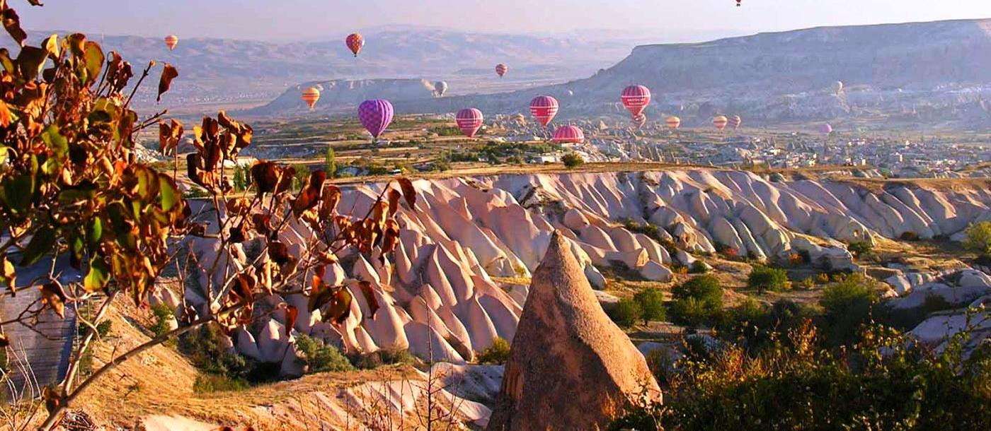 Balloons floating over Cappadocia desert in Turkey