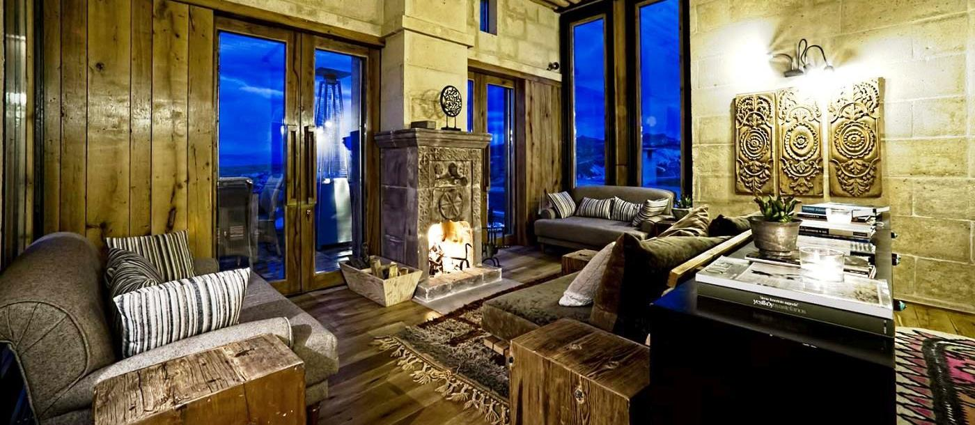 The living area with open fire in the hotel Argos in Cappadocia in Turkey