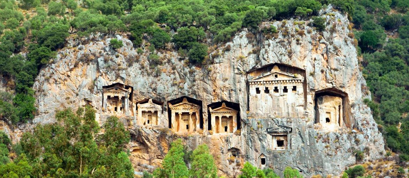 Historic tombs carved in to the cliffside at Dalyan Turkey