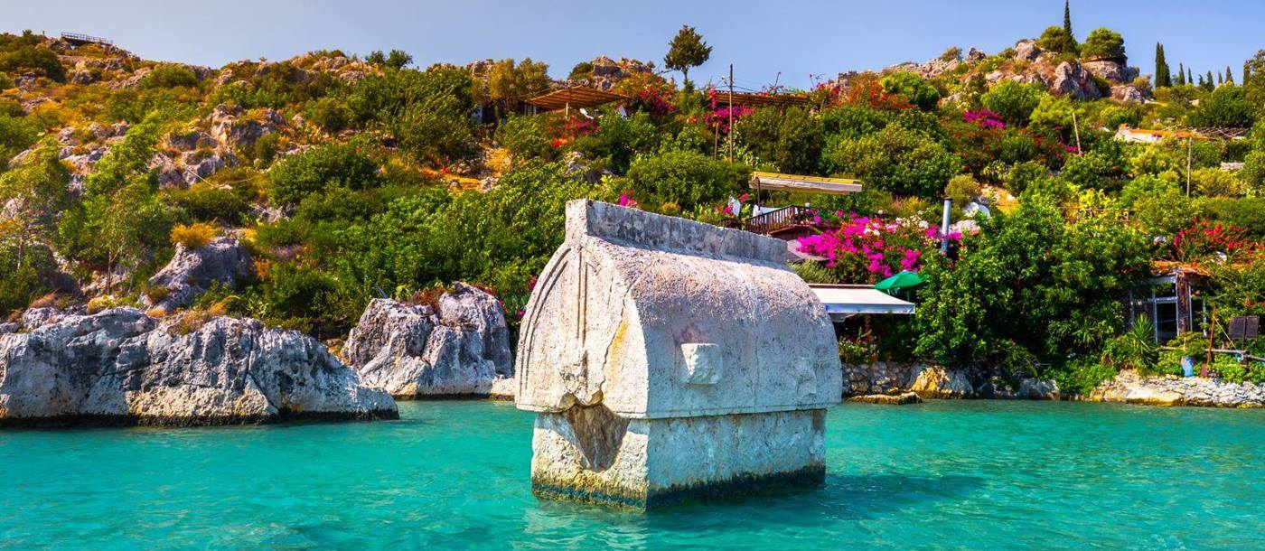 Ruins partially submerged off a picturesque beach in Kekova Turkey
