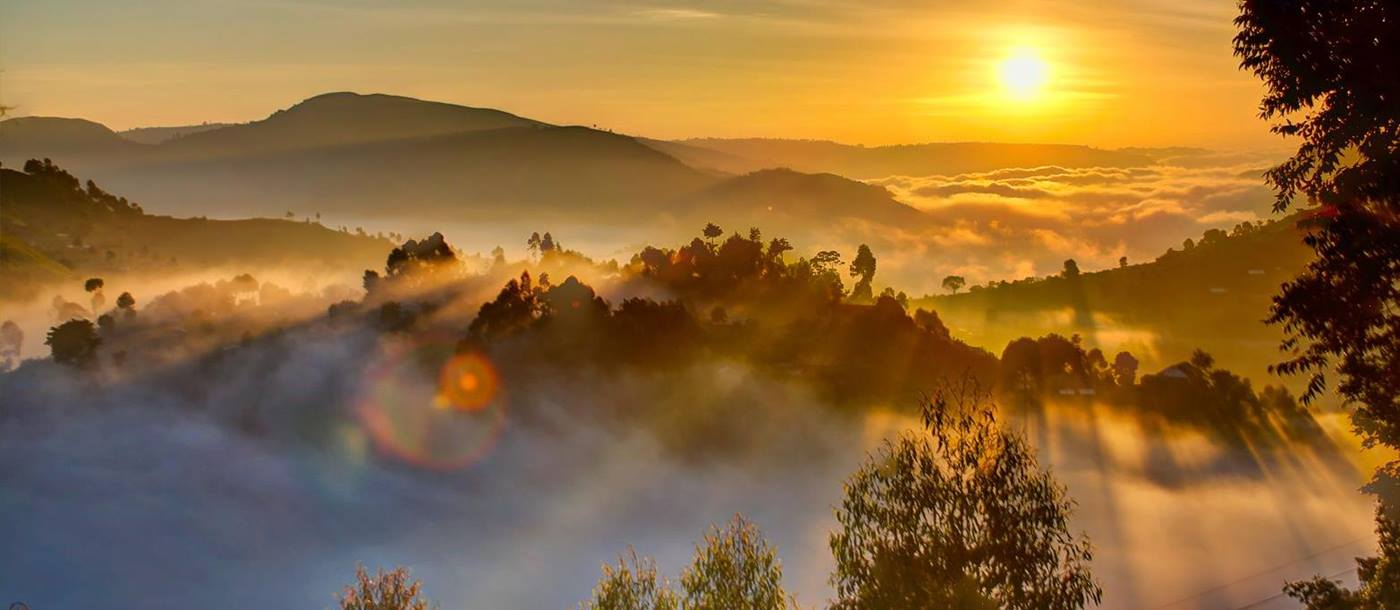 Sun rising over the misty hills of the highlands in Uganda