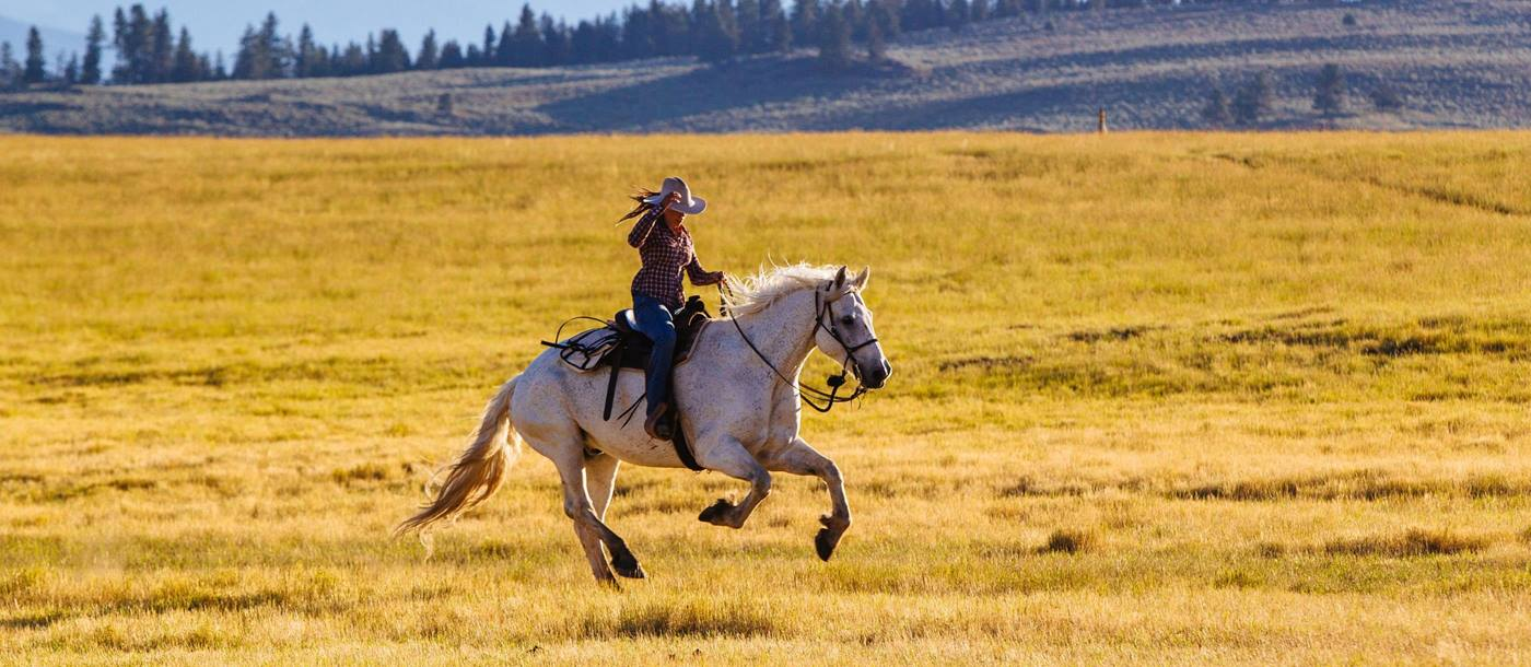 Horse riding on the lands near Paws Up Ranch, USA