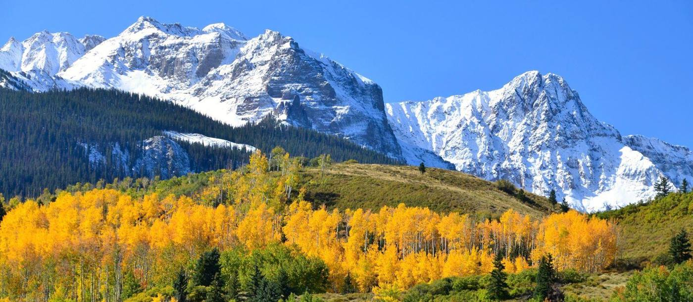 Autumn colours and the Rocky Mountains near Telluride Colorado USA