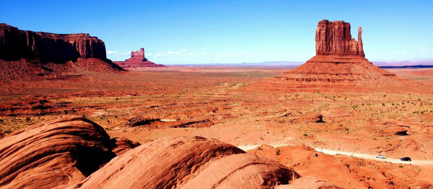 Red rock and distant view of the Monument Valley in Utah