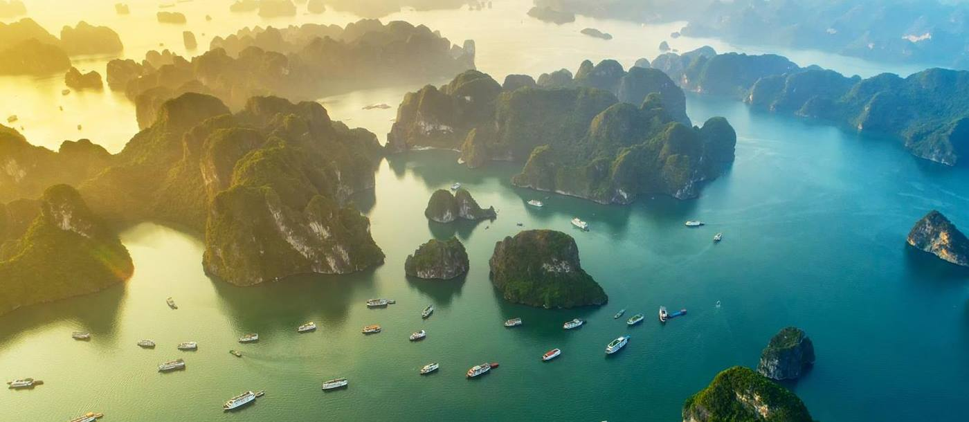 Aerial view of boats and limestone karsts in Ha Long Bay Vietnam