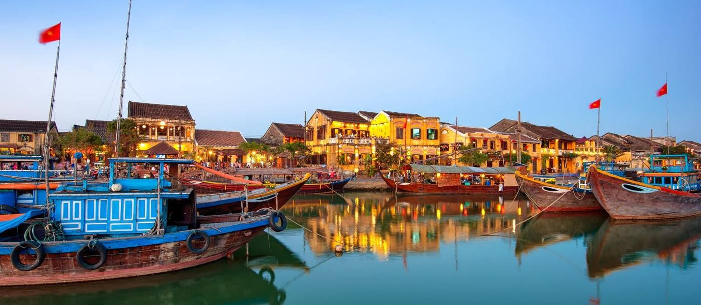 Town and river at dusk in Hoi An Vietnam