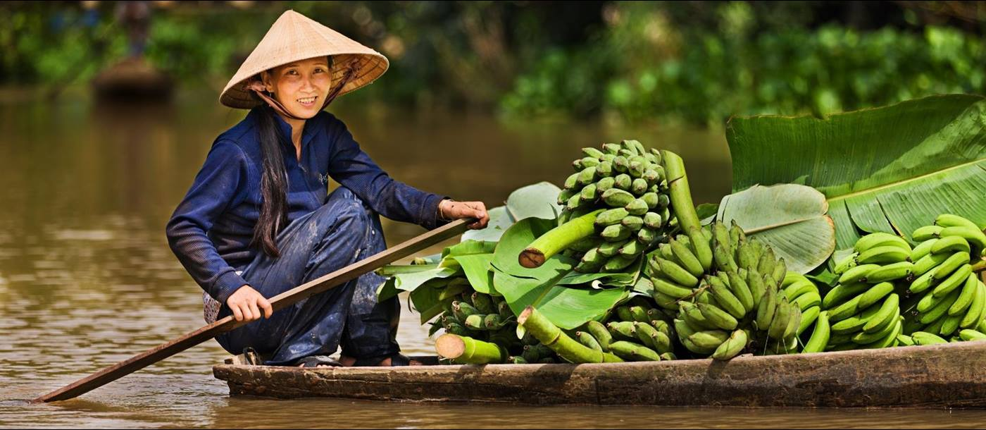 A lady on a boat on the Mekong River