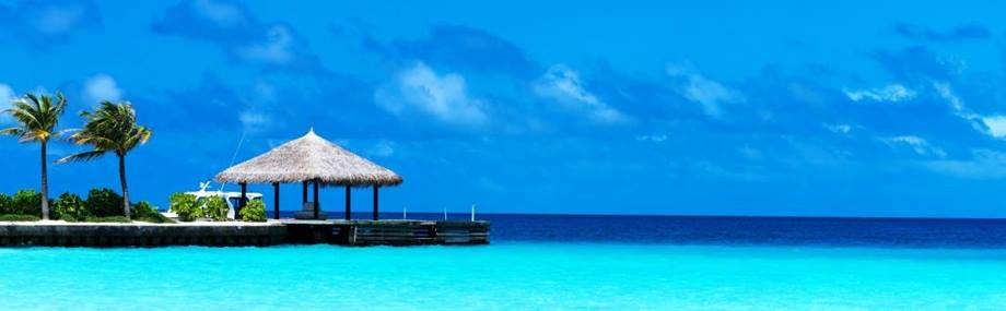 crystal blue waters at the end of a pier in the maldives, indian ocean
