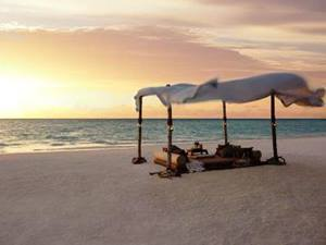 sunbeds under a canopy on a honeymoon holiday in the maldives