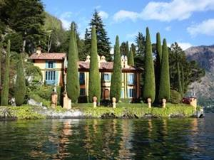 view of a private estate acrpss tje water in the italian lakes