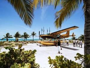 people disembarking from a seaplane at a private estate in the bahamas