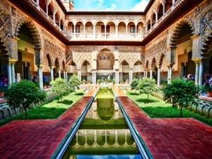 gardens in a courtyard at alcazar seville, spain