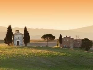 stone buildings at sunset in san quirico d'orcia, tuscany
