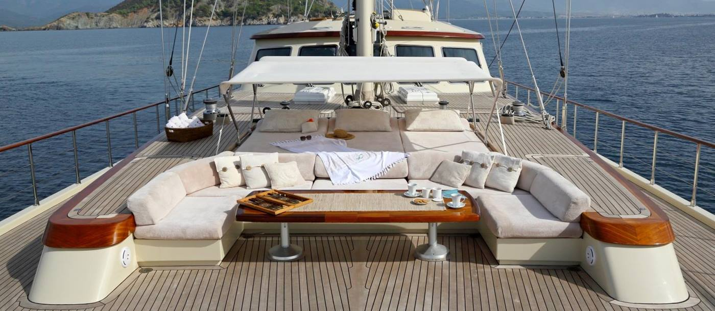 Lounging and dining area on the bow of Daima in Turkey